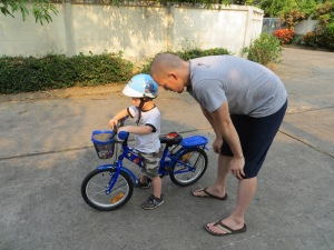 One of Elijah's new challenges is learning to ride his bike without training wheels!